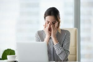 working woman with dry eyes, eye fatigue